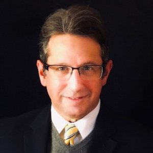 An image of Dr. Michael Wetter is captured. Dr. Wetter is featured on the Behind the Bite podcast.